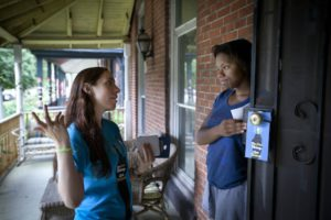 "Outreach worker Beth Rutstein (left) encourages Jhanee Franklin (right) to be tested for HIV in the mobile medical van. Outreach workers from ""Do One Thing""  go door-door handing out information that encourages people to get tested for HIV in a mobile medical van set up in the area. Zip code 19143 has the highest rate of HIV in Philadelphia. Photo by Michael S. Writz/Staff Photographer  Philadelphia Inquirer"