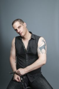 Daniel Bauer, magician, motivational speaker and HIV activist, photographed for A&U Magazine