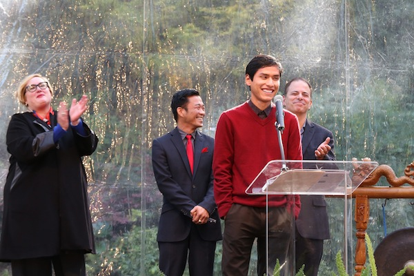 Manuel Venegas speaks while receiving his scholarship during World AIDS Day ceremony in San Francisco. Left to right: Chanel DeLaney, UnitedHealthcare; Venegas; Mark Ng, Wells Fargo; and Eric Ciasullo, National AIDS Memorial Grove.  Photo by Stuart Locklear