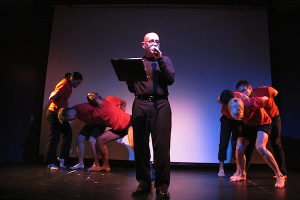 Hank Trout reading his piece alongside members of the Steamroller Dance Company. Photo by Lenore Chinn