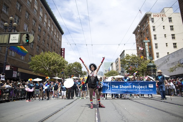 Harry Breaux, 70, a long-term AIDS survivor, runs through the2015 San Francisco Pride Celebration & Parade dressed as Dr. Frank-N-Furter from Rocky Horror Picture Show on June 25, 2015 in San Francisco, Calif. Breaux had dressed as the character for the parade 25 years prior and was recreating the costume in honor of The Shanti Project and long-term AIDS survivors.  Photo by Tim Hussin