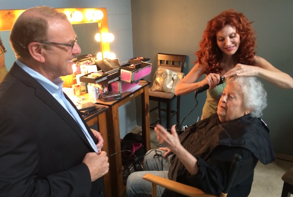YCAW Interviewees Dr. Michael Gottlieb, MD speaking to activist Ivy Bottini while getting her hair/makeup by Dee Dee Marcelli. © 2015 The Lavender Effect