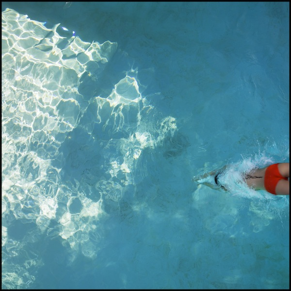 "Untitled (Swimmer), a photograph printed on canvas created by Thomas Heiser for the event, playing off its theme of ""shine"""