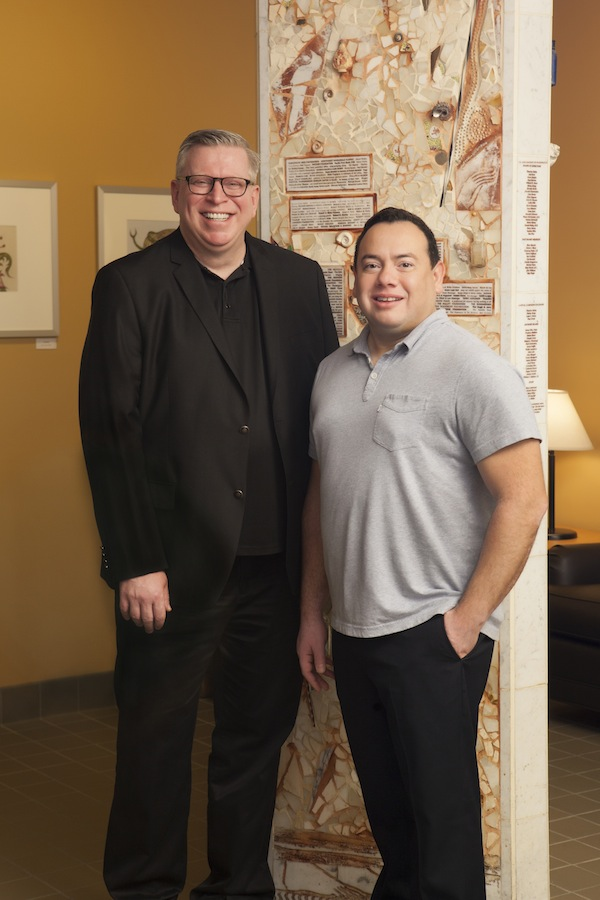 Brian Knowles (left), executive director of Bailey-Boushay House, with Ernie Munoz, chair of the Bailey-Boushay House Board of Directors. Photo by Virginia Mason Medical Center