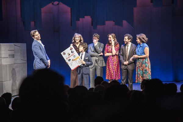 At the November 25, 2016 performance, Andrew Rannells talks about Broadway Cares with his Falsettos' cast (right to left) Betsy Wolfe, Anthony Rosenthal (holding autographed posters for sale benefiting Broadway Cares), Christian Borle, Stephanie J. Block, Brandon Uranowitz, Tracie Thoms. Photo by Sean Black