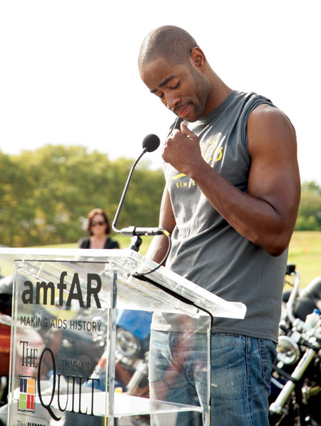 Jay Ellis at the reading of names at a presentation of the AIDS Memorial Quilt on Governor's Island at the end of Kiehl's LifeRide for amfAR in 2014. Photo by Sean Black